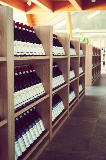 Tourist Destination Winecellar Italy Piemonte Barolo Wine Barolo Wineyards Barolo Wineyards Shelf Indoors  In A Row Large Group Of Objects Arrangement Abundance Bottle Wood - Material No People Food And Drink Wine Alcohol