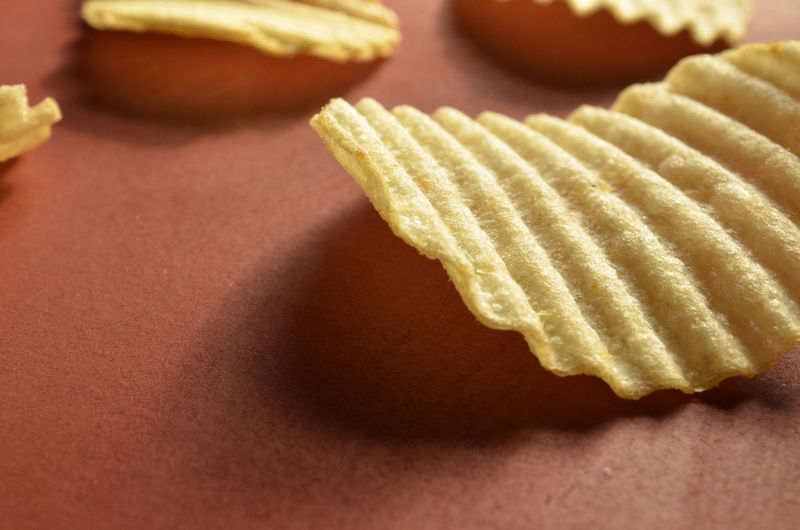Close-up of potato chips on table