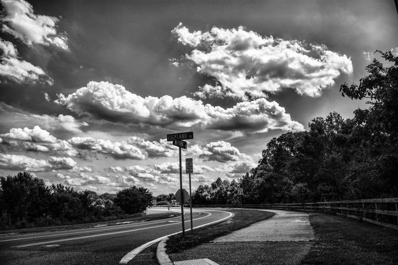Cloud - Sky Sky Road Outdoors The Way Forward Road Sign Nature Beauty In Nature Tree Day Grass Black & White Photography