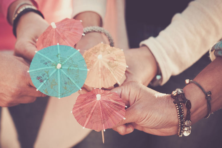 Close up women's hands together with umbrella cocktail for summer style concept and vacation in friendship colours and happiness with group of people enjoying life Human Hand Human Body Part Hand Real People Holding Close-up Focus On Foreground Leaf Plant Part Midsection Jewelry Women Lifestyles Nature Indoors  High Angle View Bracelet Leisure Activity Finger Human Limb Four People Caucasian Japan Umbrellas Females Friendship Togetherness Enjoying Life 40-44 Years Backgrounds Celebration Decoration Drink