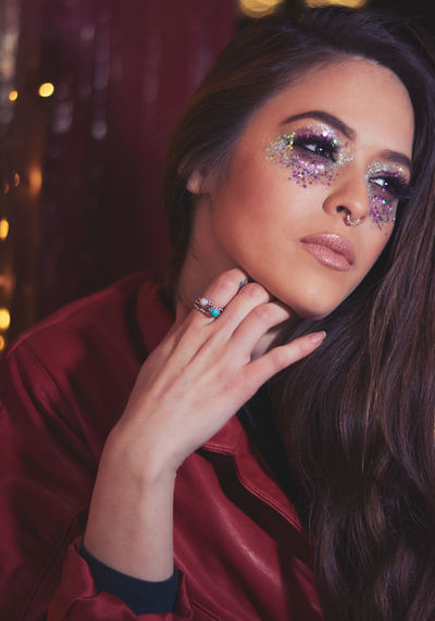 Thoughtful Young Woman With Glitter Eye Make-Up