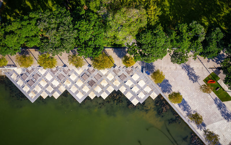 High angle view of swimming pool by lake