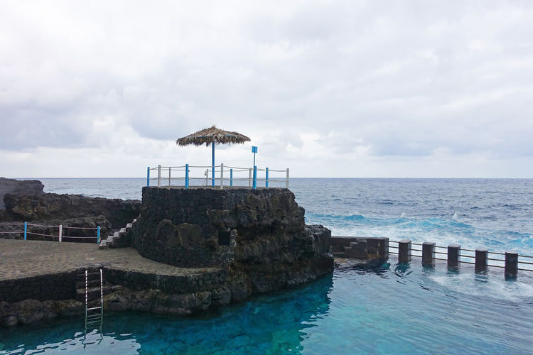 Seawaterlagoon Swimming Pool Seaside By The Sea Parasol Volcanic Landscape La Palma Island La Palma, Canarias