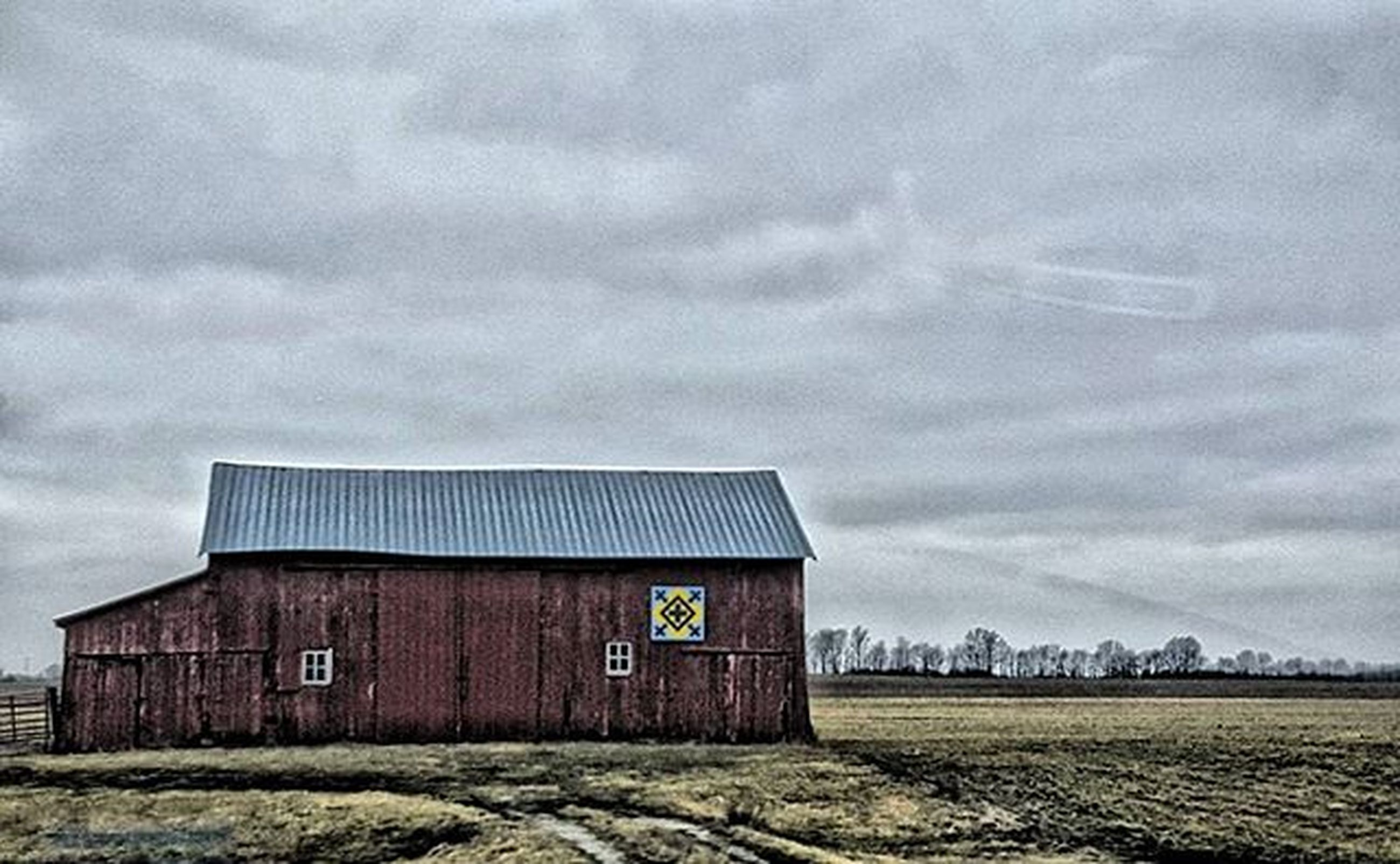 building exterior, architecture, built structure, sky, cloud - sky, field, house, cloudy, rural scene, landscape, weather, cloud, barn, overcast, outdoors, day, no people, agriculture, residential structure, nature