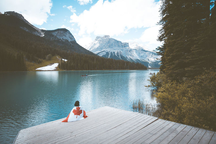 Emerald Lake / B.C. Adult Adults Only Beauty In Nature Day Full Length Jetty Lake Leisure Activity Mountain Mountain Range Nature One Person Outdoors People Rear View Scenics Sky Snow Tranquil Scene Tranquility Vacations Water