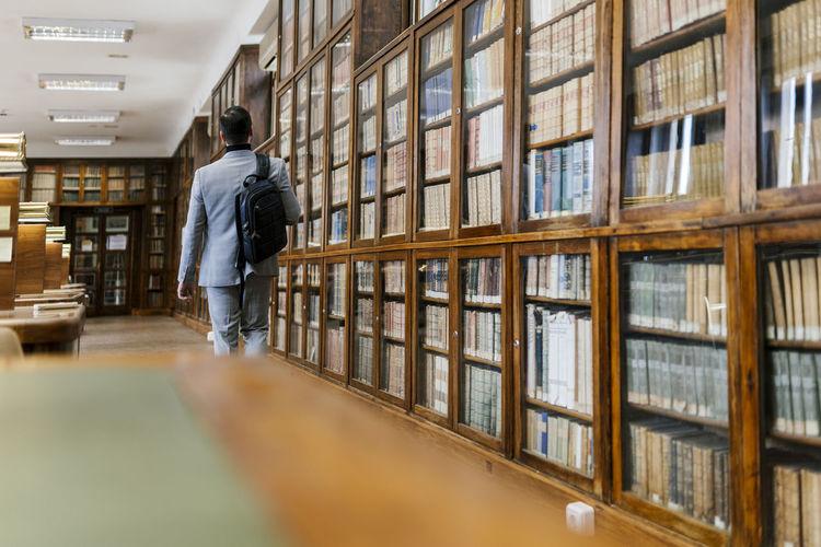 Rear view of a man walking in office