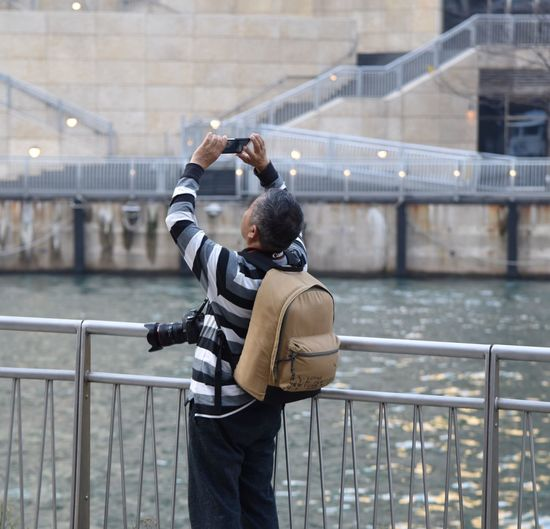 Tourist with multiple cameras taking pictures along Chicago's Riverwalk Chicago Tourist Taking Photos Multiple Cameras riverwalk