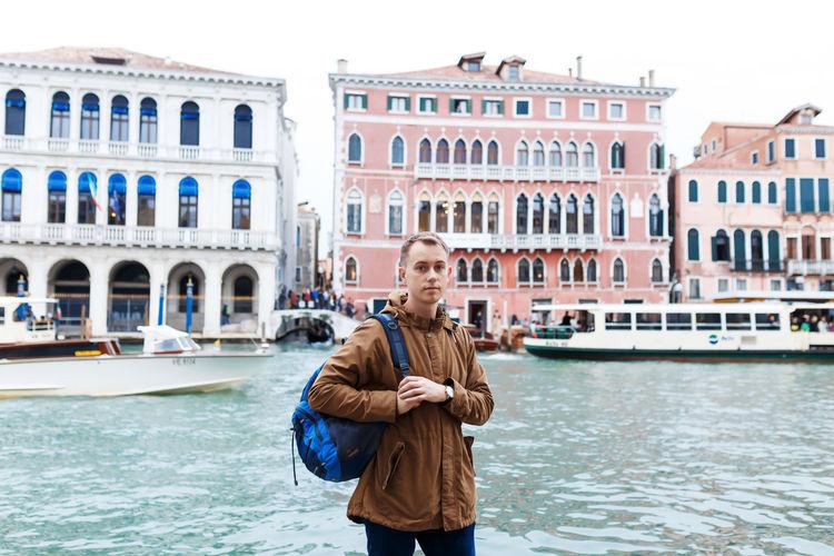Full length of man standing on boat in city