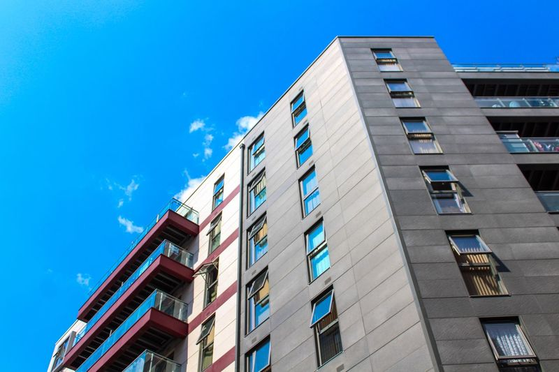 London Architecture Building Exterior Architecture Built Structure Low Angle View Sky Building Blue Window No People Clear Sky City Day Residential District Outdoors Tall - High Sunlight Modern Apartment Glass - Material