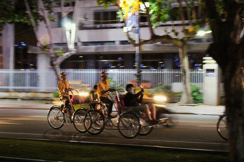 Tourism Tourist Destination Tourist Attraction  Cyclo Vietnam Da Nang, Vietnam Bicycle Transportation Mode Of Transport Land Vehicle Street Real People Illuminated City Street Night City Men EyeEmNewHere An Eye For Travel Adventures In The City