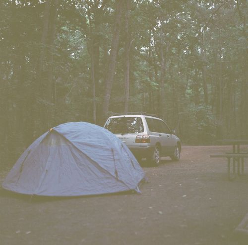 Station wagon and tent in a camp site. Backgrounds Camp Site Camping Car Curtain Film Photography Land Vehicle Light Outdoors Plastic Relaxing Moments Station Wagon Subaru Tent Transportation