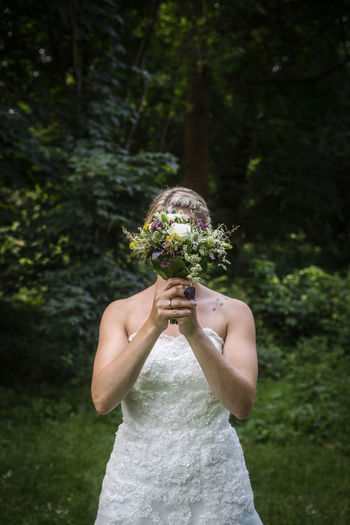Rear View Of Bride Holding A Bouquet