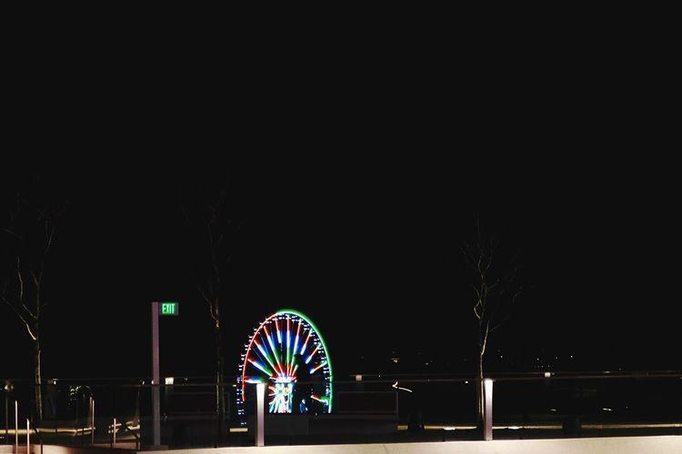 Night Amusement Park Arts Culture And Entertainment Illuminated Ferris Wheel Amusement Park Ride Multi Colored