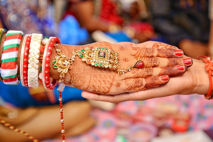 wedding photoshoot Holding Hands Indian Marriage Marriage  Marriage Ceremony Marriage Photoshoot Marriage Photography Photography Themes Studio Photography Human Hand Multi Colored Life Events Togetherness Bangle Nail Polish Women Cultures Henna Tattoo Wedding Ceremony Indian Culture  Traditional Culture Traditional Ceremony Hinduism Jewelry Ring Wedding Ring Bracelet Fingernail Groom Blessing Sari