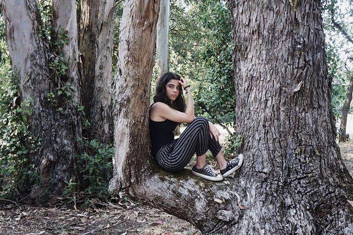 Looking At Camera Tree Forest Sitting Full Length Beauty Portrait Long Hair Beautiful People Outdoors Indie Grunge