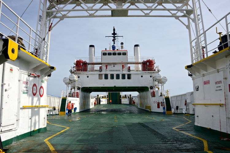 cargo deck of ferry boat Cargo Ship Ferryboat Travel Building Exterior Built Structure Cargo Deck Embarking Nautical Vessel No People Outdoors Ship Transportation