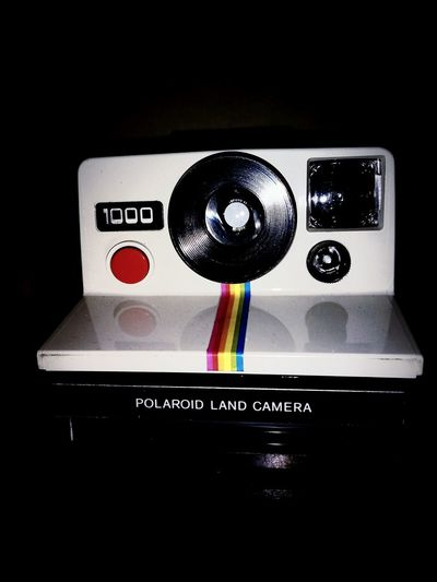 Polaroid 1000 Photography Vintage Photo Communication Text Technology Close-up No People Indoors  Black Background Day Pixelated
