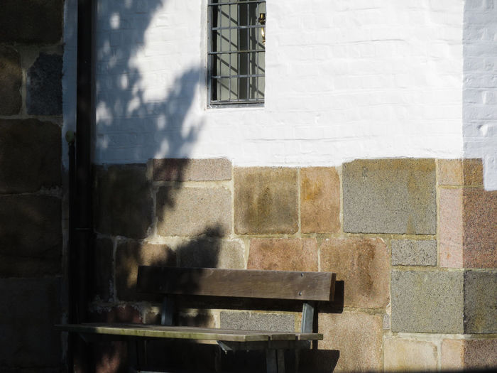 Church Bench Shadow Window Sunlight Architecture Building Exterior Built Structure Brick Wall Wall - Building Feature Exterior Stone Wall Stories From The City