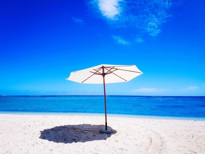Water Sea Beach Blue Relaxation Sand Summer Clear Sky Heat - Temperature Beach Umbrella Umbrella Postcard The Traveler - 2018 EyeEm Awards