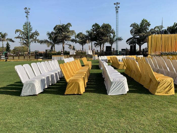 Chairs Plant Tree Nature Grass Sky Day Sunlight No People Green Color Land Growth Outdoors Field Tranquility Shadow Landscape In A Row Architecture Park Clear Sky