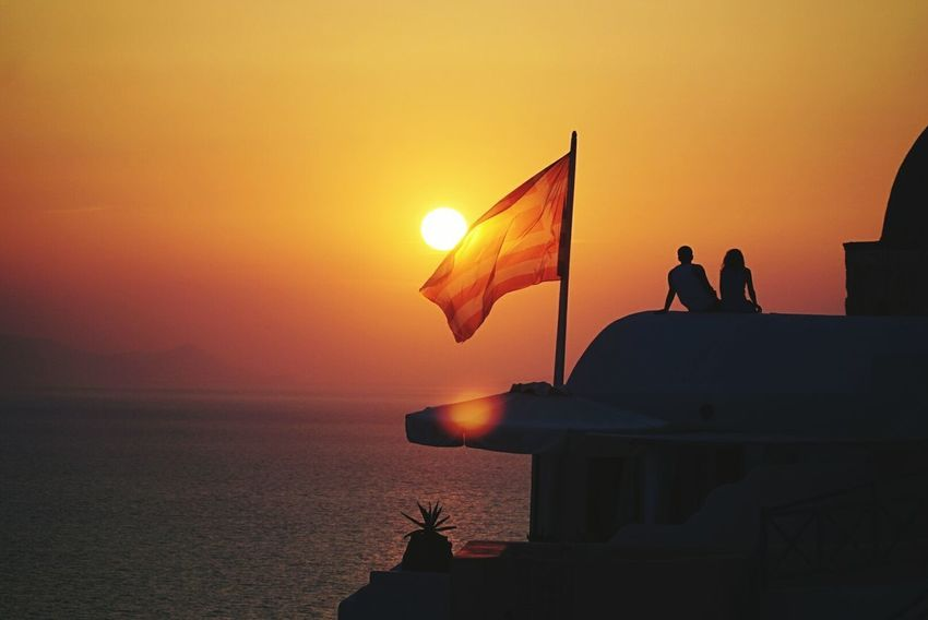 Valentine's Day  Sunset Sea Beach Sun Vacations Travel Destinations Water Dusk Sky Summer Tranquility Reflection Tourism Nature Silhouette Travel People Outdoors Adult A7s Sunlight Church Oia Santorini Oiasunset Greek Flag Let's Go. Together. Sommergefühle 100 Days Of Summer EyeEmNewHere