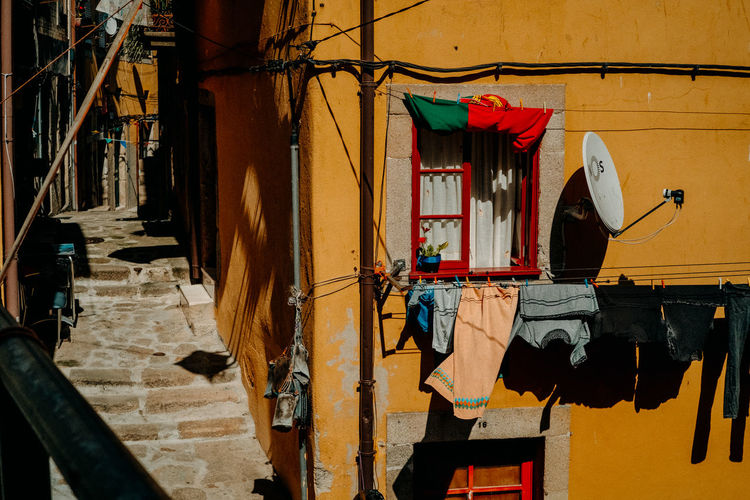 Clothes drying on wall against building
