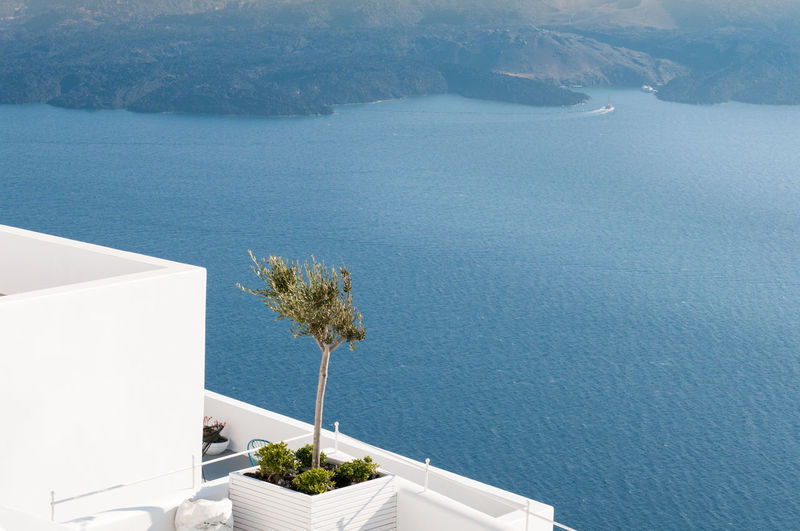 White architectural details and view of the aegean sea at oia in santorini, greece.