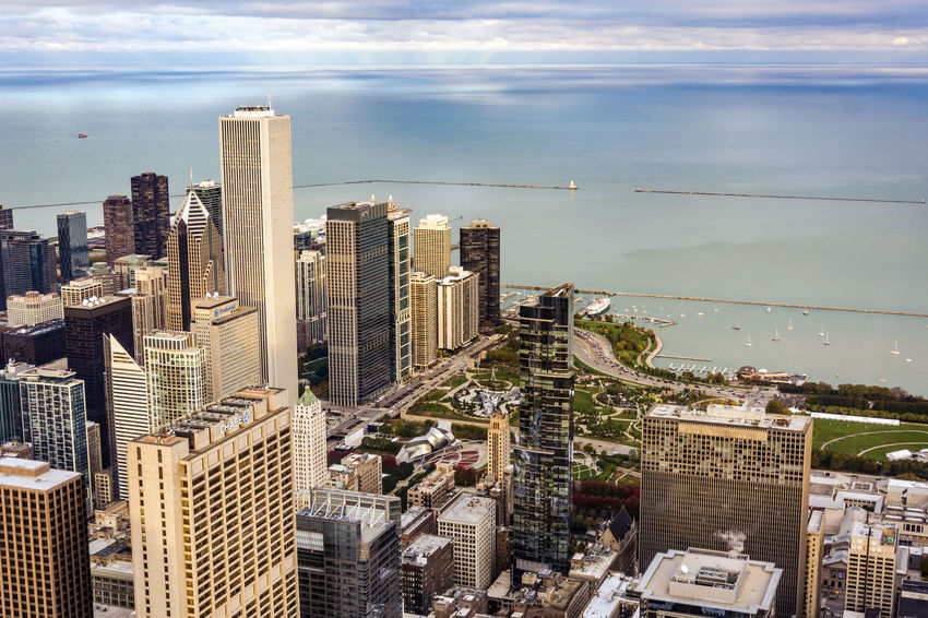panoramic view of Chicago at sunset Aerial Aerial View Architecture Building Exterior Chicago City City Life Cityscape Day Growth High High Angle View Lake Michigan Millennium Park Modern No People Outdoors Sea Sky Skyline Skyscraper Skyscrapers Towers Urban Skyline Neighborhood Map Go Higher