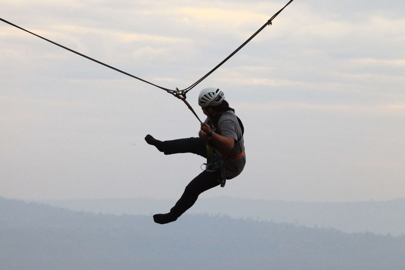 In fear there is fear. Extreme Sports Headwear Full Length Sport Flying Sports Helmet Rope Swing Mid-air Hanging Motion
