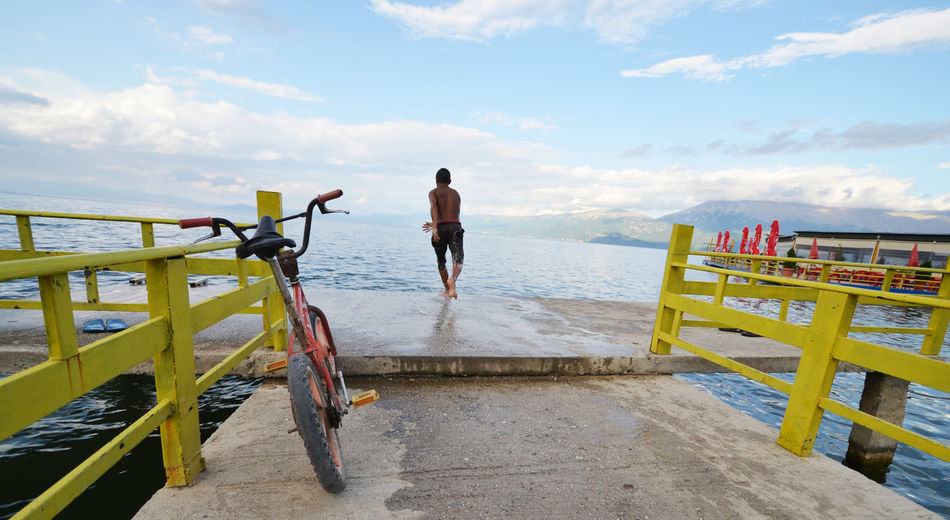 joy of summer, boy jumping into lake, lake ohrid, pogradec, albania Happy Hot Jump Lake Ohrid Pier Beauty In Nature Bike Boy Cloud - Sky Day Horizon Over Water Joy Jump In The Water  Nature Outdoors Pogradeci Railing Scenics Sea Sky Summer Water
