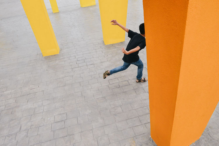 High angle view of boy running on street