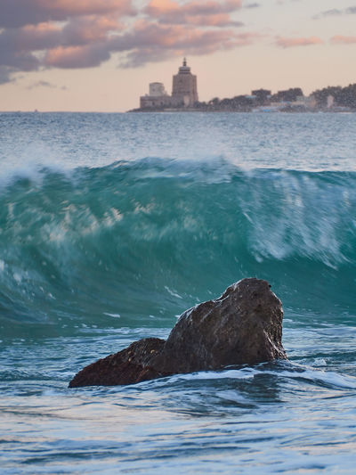Waves on Messina Cloud - Sky Sky Sunset Scenics - Nature Water Beauty In Nature Nature Sea Motion No People Waterfront Outdoors Rock Rock - Object Land Beach Rock Formation Stack Rock Wave Messina Sicily Landscape Lighthouse Italy Mediterranean Sea