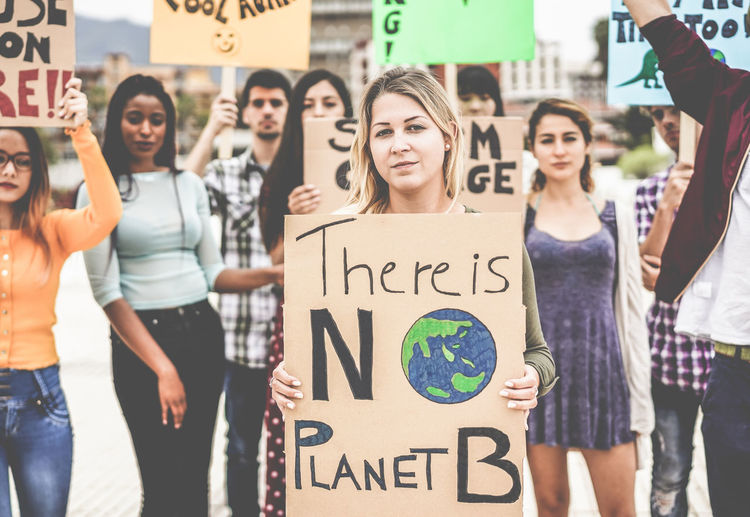 Group of demonstrators on road, young people from different culture and race fight for climate change - Global warming and enviroment concept Young Millenials Millennials People Text Group Of People Climate Change Planet Savings Young Adult Women Day City Lifestyles Marching Protestors Multiracial