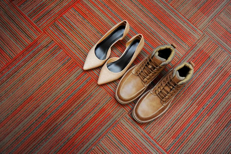 High angle view of shoes on carpet