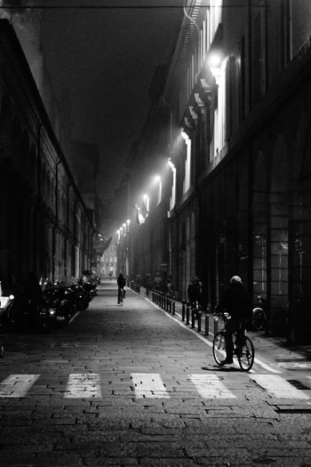 Adult Adults Only Architecture Bicycle Bologna Building Exterior Built Structure City City Life Cycling In The Fog Huawei My Year My View Illuminated Men My Year My View Night Old Town Outdoors People Piazza Verdi Real People Sky Street Transportation Via Zamboni Walking
