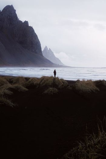 Beach Sea One Person People Sand Silhouette Outdoors Mountain Travel Destinations Beauty In Nature Scenics Adventure Power In Nature Beauty In Nature Connected By Travel Lost In The Landscape Iceland Vesturhorn Stokksnes Perspectives On Nature Be. Ready. A New Beginning