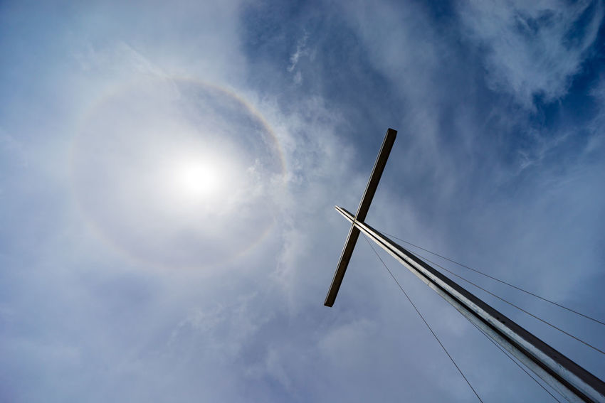Sun halo over Prayer Mountain at Bario, Sarawak. The ring is caused by sunlight passing through ice crystals in cirrus clouds within the Earth's atmosphere. BARIO Borneo Cross Sun Halo Cloud - Sky Day Environmental Conservation Low Angle View Malaysia Nature No People Outdoors Sarawak Sky