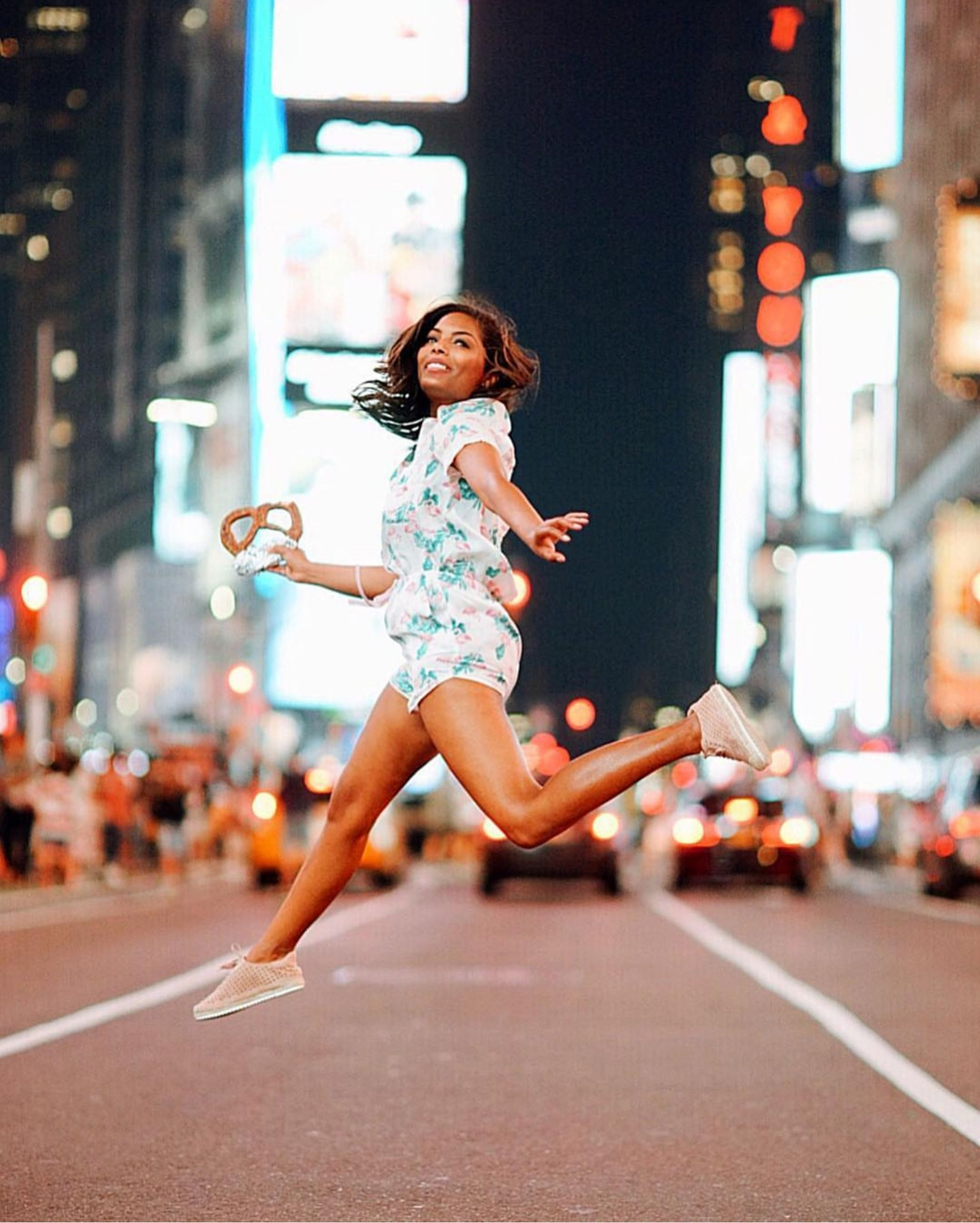 full length, city, one person, real people, lifestyles, night, street, architecture, running, mid-air, motion, leisure activity, road, women, built structure, sport, focus on foreground, building exterior, jumping, outdoors, beautiful woman