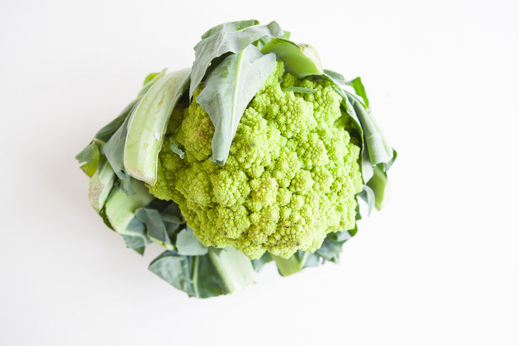 Fresh vegetables, green cauliflower on a white background top view Food And Drink Studio Shot Healthy Eating Food Wellbeing White Background Freshness Vegetable Indoors  Still Life Green Color Close-up Cut Out No People Raw Food Directly Above Organic Cauliflower Single Object High Angle View Vegetarian Food