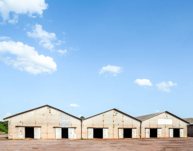 old rice warehouse and blue sky background Abandoned Architecture Background Blue Building Cargo Commercial Concrete Depot Door Exterior Factory Industrial Industry Metal Old Outdoors Roof Sky Storage Storehouse Warehouse Waste