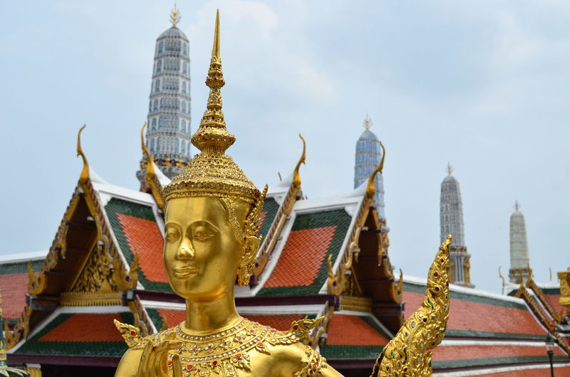 Gold Statue Against Sky At Wat Pho