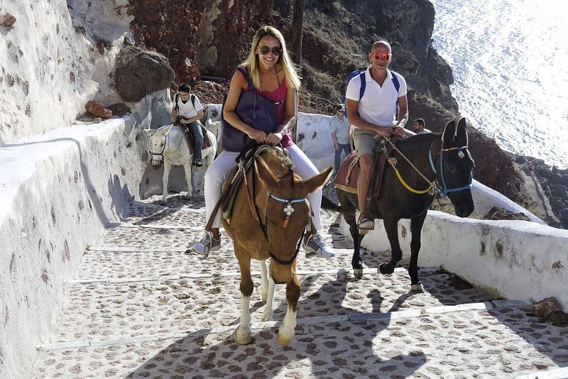 Horse Horseback Riding Riding Domestic Animals Full Length Cowboy Hat Adult Cowboy Togetherness People Adults Only Women Mature Adult Sand Mammal Working Young Women Two People Outdoors Vacations Architecture Santorini, Greece Sky Streetphotography