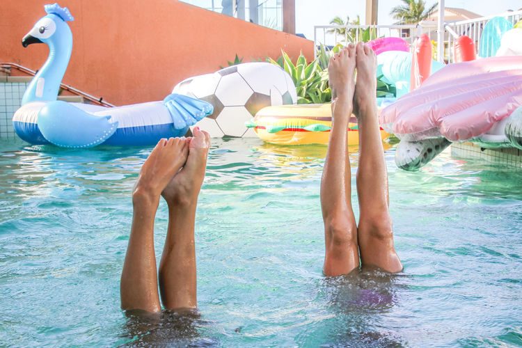 handstands in the pool, summertime fun, girls, friendship, legs Water Pool Swimming Pool Lifestyles Leisure Activity Real People Low Section Waterfront Inflatable  Two People Enjoyment Day Relaxation Holiday Body Part Pool Raft Outdoors Submerged Handstand  Childhood Girls Human Leg Fun Summertime Friendship