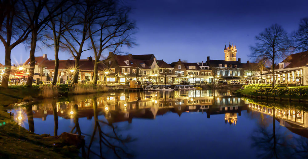 Sluis, Zeeland during blue hour Architecture Blue Building Exterior City Clear Sky Dusk Evening Evening Sky Illuminated Night Night Lights Night Photography Night View Nightphotography Reflection Sky Standing Water Tree Water