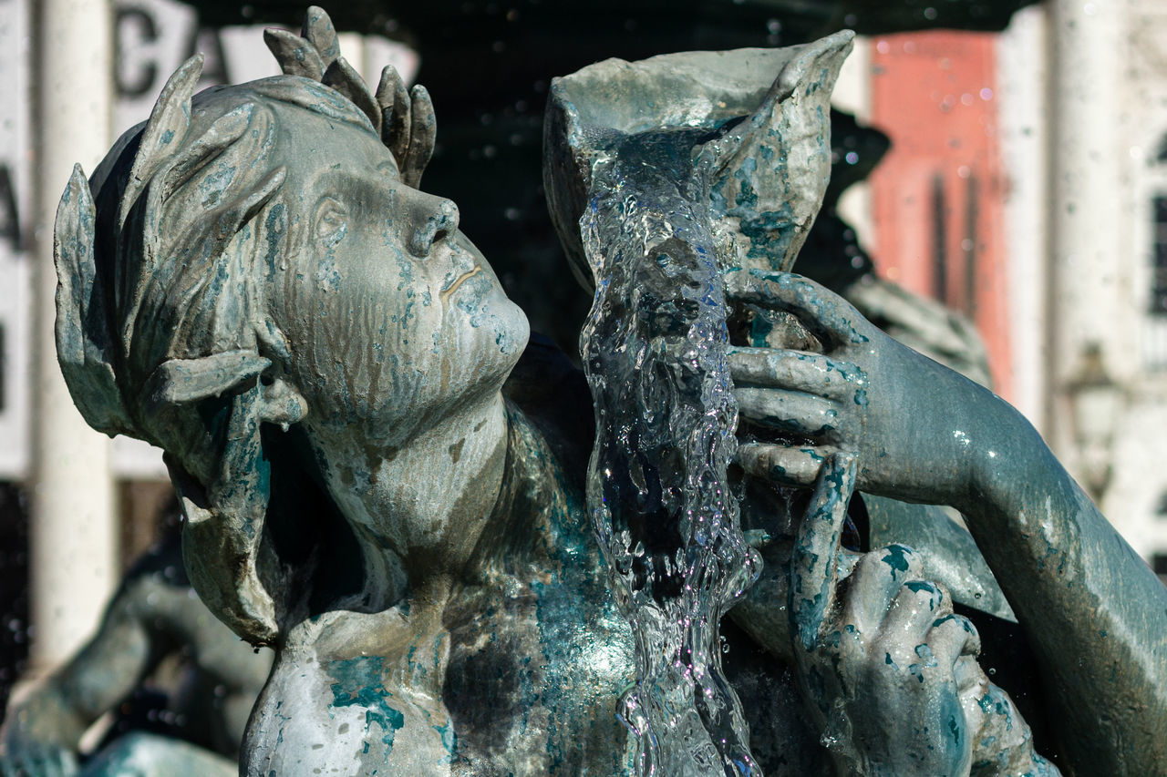 statue, art and craft, sculpture, no people, close-up, outdoors, day, water