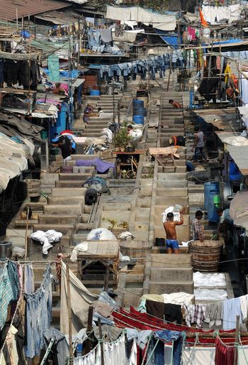 Workers cool at Mahalaxmi Dhobi Ghat, Mumbai's washing and laundry district. Architecture Built Structure Clothes Dhobighat Drying Hard Work Hard Worker Hard Working Heat Heat - Temperature Incidental People India Intense Large Group Of Objects Laundry Lifestyles Men Mumbai Occupation Poverty Washing Working