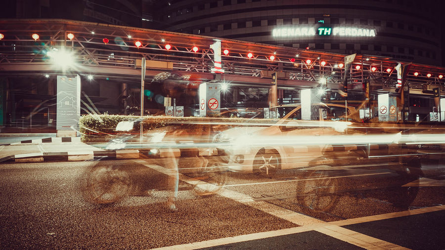 glimpse of motorcyclist and cars on a road at Kuala Lumpur Malaysianphotographer SONY A7ii EyeEm Selects Kuala Lumpur, Malaysia Kuala Lumpur City Centre Motorcycle Photography Motorcycle Trip Cyclists In Landscape Motorcycle Car Cars Road