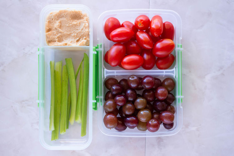 Healthy Meal Meal Choice Close-up Container Directly Above Food Food And Drink Freshness Fruit Grape Green Color Healthy Eating High Angle View Large Group Of Objects Meal Prep Red Snack Still Life Tomato Vegetable Wellbeing