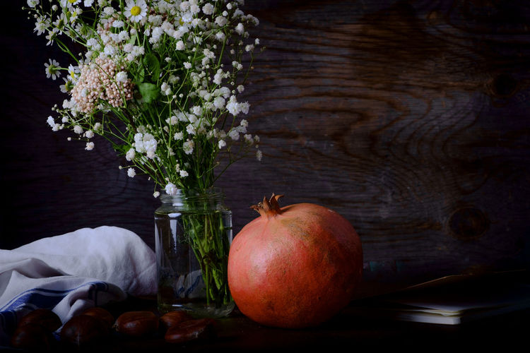 Autumn Fruits, Pomegranate and Chestnuts Chestnuts Apple Apple - Fruit Close-up Flower Flower Arrangement Flowering Plant Food Food And Drink Freshness Fruit Healthy Eating Indoors  Nature No People Plant Pomegranate Still Life Table Vase Wellbeing Wood - Material