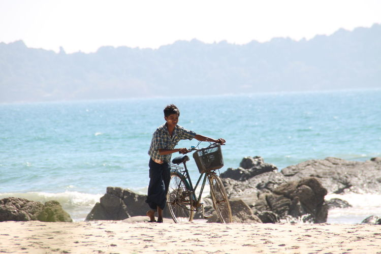 Ngapali Beach, Myanmar Beach Beauty In Nature Casual Clothing Day Full Length Horizon Horizon Over Water Land Leisure Activity Lifestyles Men Nature One Person Outdoors Real People Scenics - Nature Sea Sky Sunlight Water